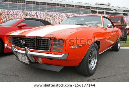CONCORD, NC - SEPTEMBER 21:  A 1969 Chevy Camaro SS on display at the Charlotte Auto Fair classic car show at Charlotte Motor Speedway in Concord, North Carolina, September 21, 2013. - stock photo