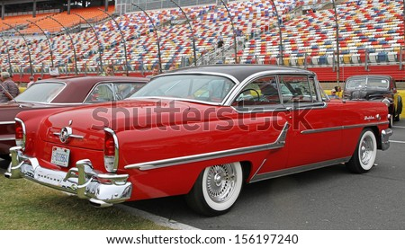CONCORD, NC - SEPTEMBER 21:  A 1955 Mercury Montclair on display at the Charlotte Auto Fair classic car show at Charlotte Motor Speedway in Concord, North Carolina, September 21, 2013. - stock photo