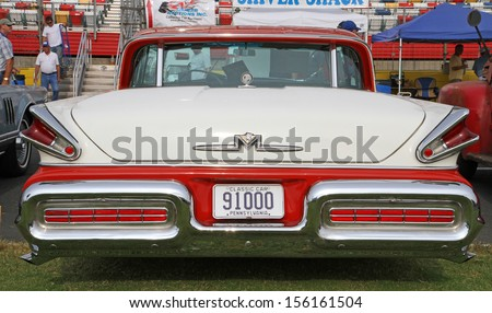 CONCORD, NC - SEPTEMBER 21:  A 1957 Mercury Turnpike Cruiser on display at the Charlotte Auto Fair classic car show at Charlotte Motor Speedway in Concord, North Carolina, September 21, 2013. - stock photo