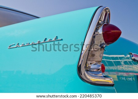 CONCORD, NC -- SEPTEMBER 20, 2014:  Closeup of a tail light of a 1956 Chevrolet automobile on display at the Charlotte AutoFair classic car show held at Charlotte Motor Speedway. - stock photo