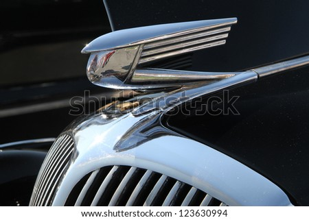 CONCORD, NC - SEPTEMBER 22: Closeup of hood ornament on a 1936 Buick on display at the Charlotte AutoFair classic car show at Charlotte Motor Speedway in Concord, North Carolina, September 22, 2012. - stock photo