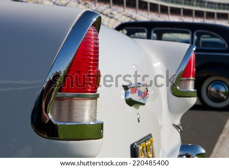 CONCORD, NC -- SEPTEMBER 20, 2014:  Closeup of tail lights of a 1955 Chevrolet automobile on display at the Charlotte AutoFair classic car show held at Charlotte Motor Speedway. - stock photo