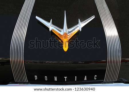 CONCORD, NC - SEPTEMBER 22:  Hood ornament of 1955 Pontiac automobile on display at the Charlotte AutoFair classic car show at Charlotte Motor Speedway in Concord, North Carolina, September 22, 2012. - stock photo