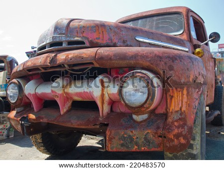 CONCORD, NC -- SEPTEMBER 20, 2014:  Unrestored 1951 Ford pickup truck on display at the Charlotte AutoFair classic car show held at Charlotte Motor Speedway. - stock photo