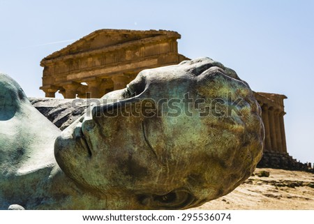 Concordia Temple behind the bronze sculpture of Icarus, person of greek mythology - Valley of the temples  - stock photo
