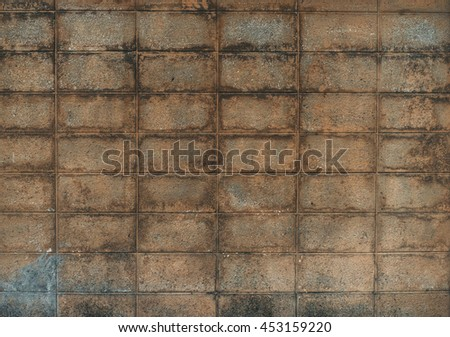 """Concrete block aged worn brown wall. Industrial wallpaper. Copy space. """"Under construction"""" web wallpaper concept. Vintage effect.  - stock photo"""