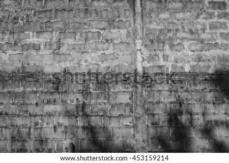 "Concrete block aged worn wall. Industrial wallpaper. Copy space. ""Under construction"" web wallpaper concept. Vintage effect.  - stock photo"