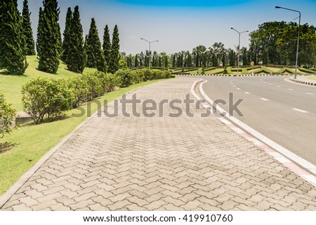 Concrete block footpath in the park - stock photo