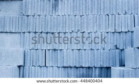 concrete block of construction.Stacks of interlocking  - stock photo