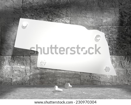 concrete blocks empty room with clear outline nebraska state map attached to wall by bolts - stock photo
