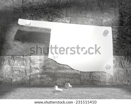 concrete blocks empty room with clear outline oklahoma state map attached to wall by bolts - stock photo