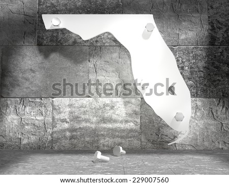 concrete blocks empty room with white florida outline map attached by steel bolts - stock photo
