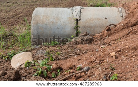 Concrete Drainage Pipe on a Construction Site .Concrete pipe stacked sewage water system aligned on site. Thailand.