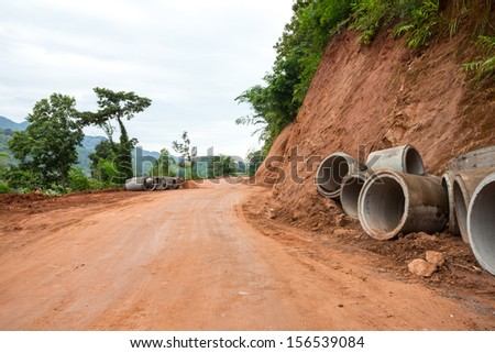 Concrete drainage pipe on a construction site in Thailand - stock photo