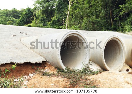 Concrete drainage pipes on construction site - stock photo