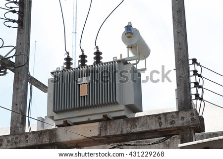 Concrete electric pillar with crossing cables.electric transformer on pole. - stock photo
