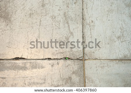 Concrete floor and brass bar close up for background pattern. - stock photo