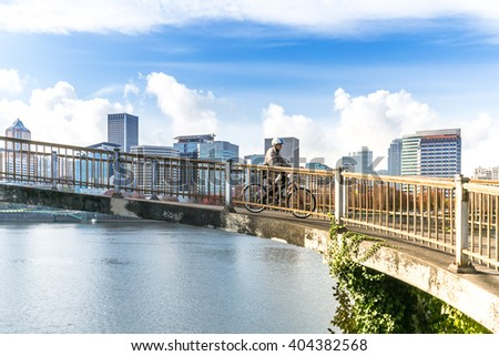 concrete footpath near water with cityscape and skyline in portland