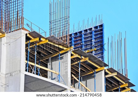Concrete formwork and floor beams on construction site - stock photo