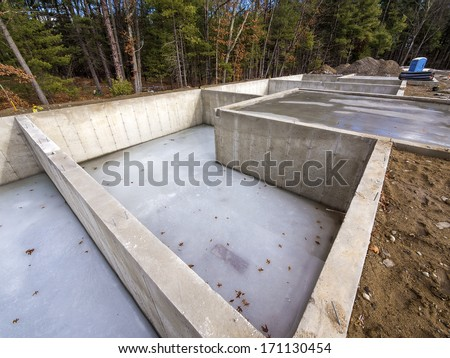 Concrete foundation for new houses - stock photo