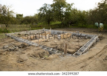 concrete foundation of new house in the garden