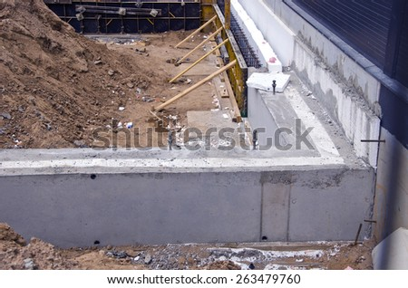 concrete foundation urban house with insulation material - stock photo