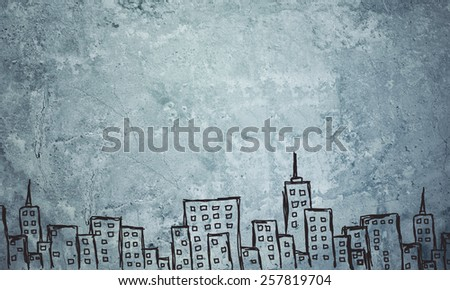 Concrete gray wall with fissure. Sketch of painted buildings