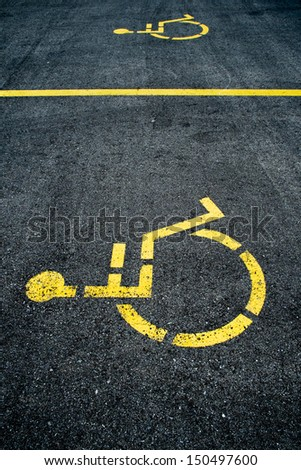 Concrete handicapped sign with wheelchair