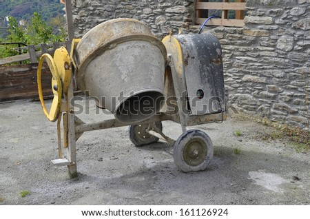Concrete mixer in a workplace. Construction machinery for mixing cement - stock photo