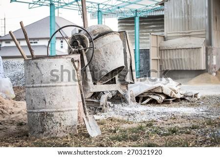 concrete mixer on a building site - stock photo