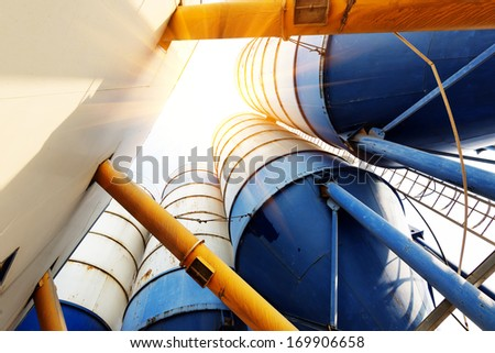 Concrete mixing tower. Concept of on-site construction facility. - stock photo
