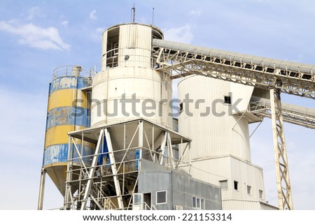Concrete mixing tower. on-site construction facility. - stock photo