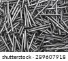 Concrete nail on white background - stock photo