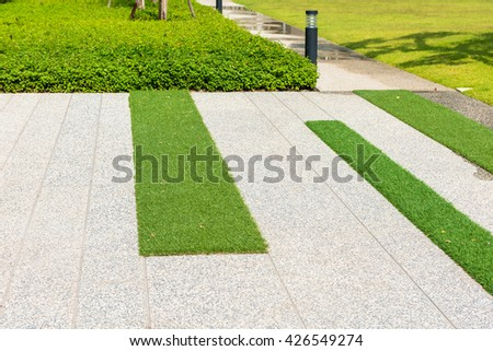 concrete pathway and artificial grass