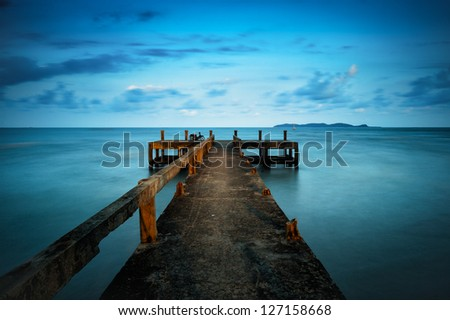 concrete pier in the evening - stock photo