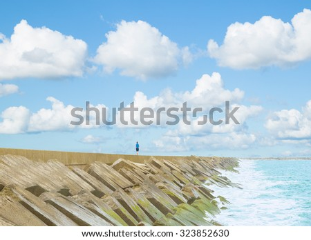 Concrete pier into sea on a summer day