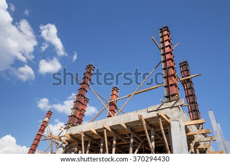 concrete pillar mold for house construction at construction site - stock photo
