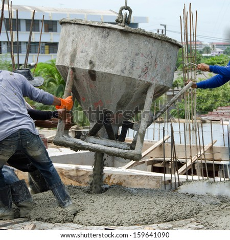 Concrete pouring during commercial concreting floors of buildings in construction.  - stock photo