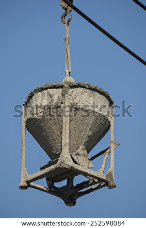 Concrete pouring during commercial concreting floors of buildings in construction blue background. - stock photo