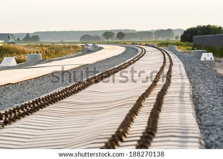 Concrete railroad ties in railway construction site - stock photo