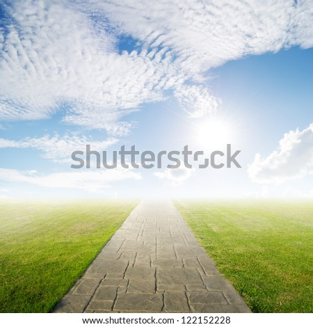 Concrete road in Grass fields and Sun sky - stock photo