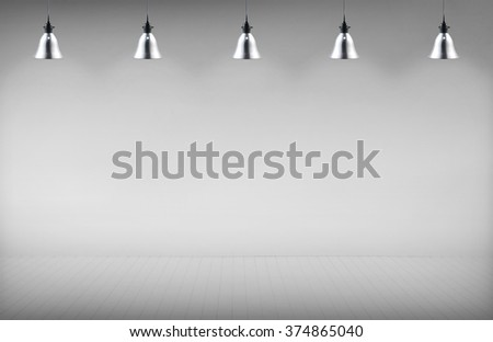concrete room with five ceiling lamps - stock photo