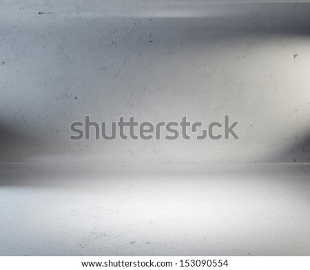 concrete room with spotlights on the wall - stock photo