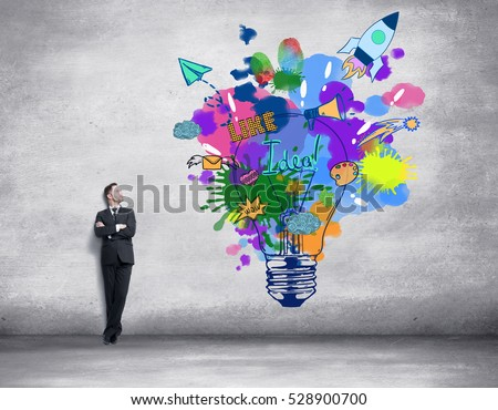 Concrete room with tiny businessman and huge colorful light bulb sketch. Creative idea concept
