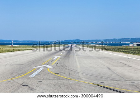 concrete runway at Marseille Provence Airport in France - stock photo