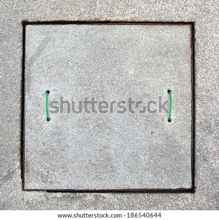 Concrete sewer manhole cover - stock photo