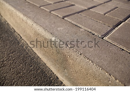 concrete sidewalk closeup and pavement - stock photo