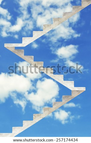 concrete staircase going up into a blue sky, stairway to heaven - stock photo