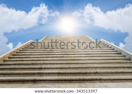 concrete staircase going up into a bright light sky