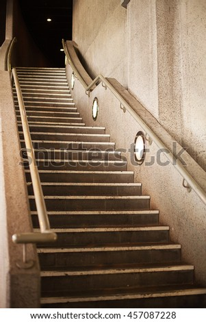 Concrete staircase leading to rear entrance of a building - stock photo